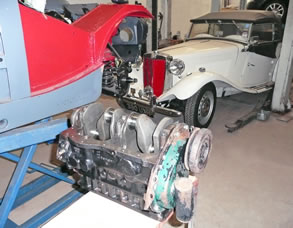 MG Midget and TD in the workshop with stripped down engine